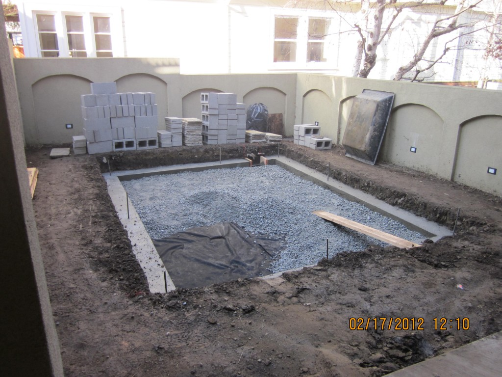 We Faced The Cinder Block Wall With Petrified Seashore Veneer And Installed  A Petrified Seashore Flagstone Patio. Finally, We Softened Up The Space  With A ...